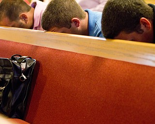 Geoffrey Hauschid|The Vindicator.6.25.2010.OVTC residents rest their head on the pew in front of them while attending a graduation ceremony and water baptism for two graduates of OVTC at Youngstown Christian Assembly.