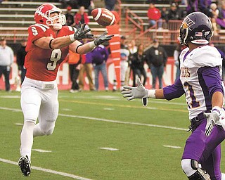 YSU's Will Shaw (9) intercepts a ball intended for Iowa's Josh Collins (21).