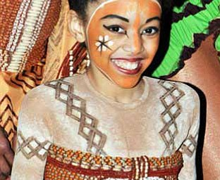 "In this March 25, 2010 photo provided by Disney Theatrical Productions, actress Shannon Tavarez is seen backstage at the Minskoff theater in New York where she was playing the part of Young Nala in the Broadway musical, ""The Lion King.""  Tavarez, 11, died Monday Nov. 1, 2010, after losing her battle with Leukemia. A founder of the bone marrow donor center DKMS, said Tavarez died at Cohen Children's Medical Center in New Hyde Park, on Long Island. (AP Photo/Disney Theatrical Productions, Jenny Anderson)"