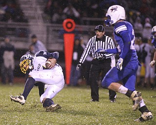 ROBERT K. YOSAY | THE VINDICATOR.. McDonald #31  Zach Tura makes a cut and falls after making a first down behind him is  #24 Reserve Thomas Benyo during first quarter action.. McDonald @ Western Reserve - first round .Ó--30-..