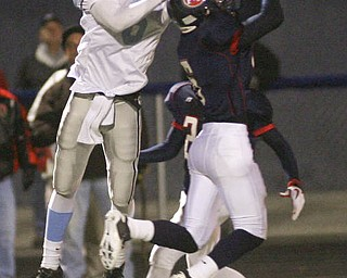ROBERT  K.  YOSAY  | THE VINDICATOR --..six on six  as Falcons #6  Lucas Haupt - breaks up a pass intended for  the Rebels #6  Devyn Woods during second quarter action at First round of playoffs as Willoughby South Rebel at Austintown Fitch Falcons  ... -30-..(AP Photo/The Vindicator, Robert K. Yosay)