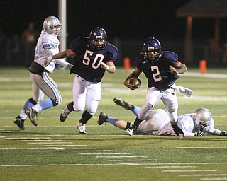 ROBERT  K.  YOSAY  | THE VINDICATOR --..  #2  Demitrious Davis Takes off and leaves  #55  Gianni Tutolo  sprawled as #50 fitch  Zac Carpenter follows  #22 Tyler Rus   for the rebels watches First round of playoffs as Willoughby South Rebel at Austintown Fitch Falcons  ... -30-..(AP Photo/The Vindicator, Robert K. Yosay)