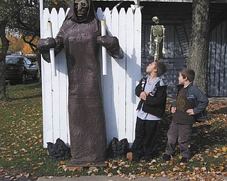 Nathan and Nicholas Burgermyer show some bravery, despite not wanting to go into the annual haunted house set up by Jason Burgermyer of Cortland and his nephews Craig Bash and Mike Burgermyer. Photo sent in by Barb Bradford.