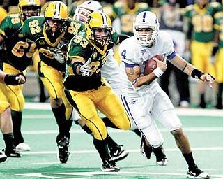 North Dakota State defenders, including Coulter Boyer (92) and Cole Jirik (93) chase after Indiana State quarterback Ronnie Fouch (4) during an NCAA college football game, Saturday, Oct. 23, 2010, in Fargo, N.D.  North Dakota State won 27-15. (AP Photo/The Forum, Dave Wallis)