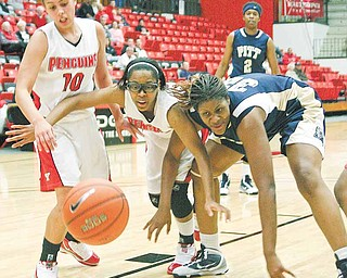 YSU - PITT - (10) Maryum Jenkins and (5) Kenya Middlebrooks fight with (32) Selena Nwude for the ball during their game Wednesday night. - Special to The Vindicator/Nick Mays