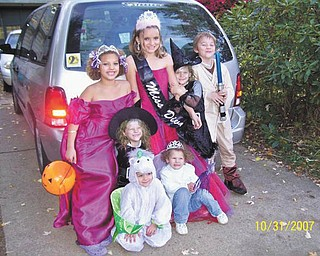 Carol Doll of Austintown said this photo she sent in is her favorite Halloween photo because it has all seven of her grandchildren in it. They are, front row, Arilyn Johnson and Breannah Johnson, and back row, Jennifer Doll, Deianira Johnson, Alyssa Johnson, Destiny Johnson (she and Deianira are twins) and Codey Johnson.