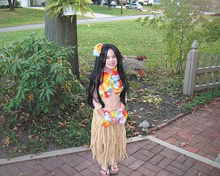 Decked out in Hawaiian gear, Sidney Laughner of Youngstown looks like she's ready for a warm Halloween.