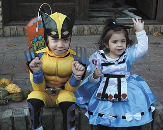 Carmine White, 4, strikes a pose as Wolverine, while Gemma White, 19 months, is sitting pretty as Alice in Wonderland. They live in Canfield. The photo was sent in by their mom, Joanna White.