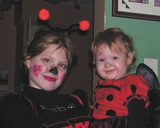 Sierra and Chelsea Campbell of Youngstown aren't bugged at all. Photo sent in by Christina Campbell..