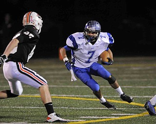 Lakeview's Toma Leveto, 7, tries to slip pasr Chagrin Fall's defenderKyle Weber, 45, during their game at Arura on friday night. Photo/Mark Stahl