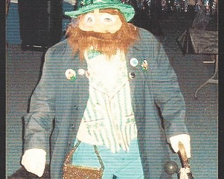 Bill Maine of Boardman has been dressing up as a leprechaun for 15 years. He got the idea from comedian Tim Conway, who stood in a hole but wasn't mobile. Not so for Maine, who dances to rock 'n' roll for a few hours each night as part of the performance. Normally, Maines is 5 foot, 8 inches tall, but when in costume, he's 4 foot tall.