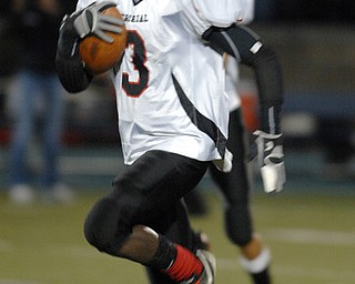 Campbell's Jales Hughes (03) runs the ball against Manchester on Friday night at Ravenna High School Stadium.