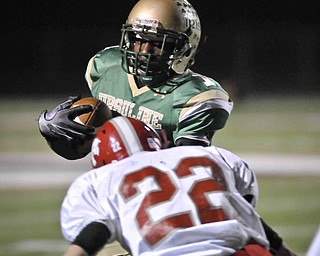 Ursulines Trevor Smith runs over Norwayne's Dustin Grier during their game at Green on Saturday night. photo/Mark Stahl