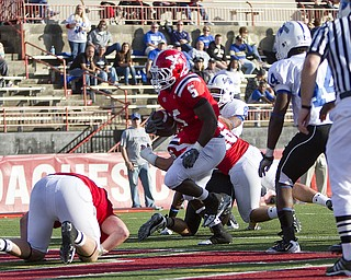 Geoffrey Hauschild|The Vindicator.YSU's Randy Louis (5) finds a hole and runs the ball into the endzone for a touchdown during the third quarter of a game at YSU's Stambaugh Stadium on Saturday afternoon.