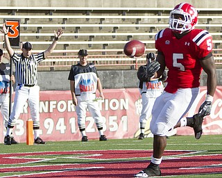Geoffrey Hauschild|The Vindicator.YSU's Randy Louis (5) tosses the ball aside after finding a hole and running the ball into the endzone for a touchdown during the third quarter of a game at YSU's Stambaugh Stadium on Saturday afternoon.