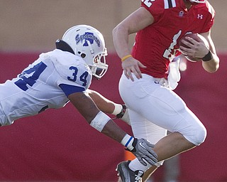 Geoffrey Hauschild|The Vindicator.Indiana State's Jacolby Washington (34) brings down YSU's quarterback, Kurt Hess (12), as he tried to scramble during the third quarter of a game at YSU's Stambaugh Stadium on Saturday afternoon.