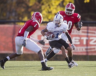 Geoffrey Hauschild|The Vindicator.Indiana State's Bryant Kent (1) makes his way downfield though ultimately being brought down by YSU's Brandian Ross (1) and Obinna Ekweremuba  (90) during the fourth quarter of a game at YSU's Stambaugh Stadium on Saturday afternoon.