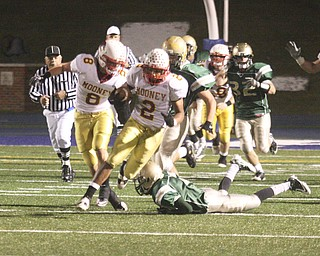 PLAYOFF - Charlie Brown looks for running room during their game Saturday night. - Special to The Vindicator/Nick Mays