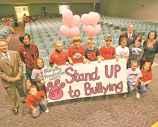 Struthers Middle School kicked off Bullying Prevention Week at an assembly Monday morning. From left are Struthers Mayor Terry Stocker and guidance counselor Kendra Broome. Kneeling is fifth-grader Jacob Dankovich. Clockwise around the sign are sixth-grader Jenna Farkas, sixth-grader Brianna Ostrowski, eighth-grader Matthew Bollinger, eighth-grader Ryan Kern, sixth-grader John Medvec, eighth-grader Nigeria Morgan, fifth-grader Channon Adriana Wuattro and fifth-grader Mariah Mass. Behind them is school principal Peter Pirone and Yvonne Wilson, juvenile diversion officer.