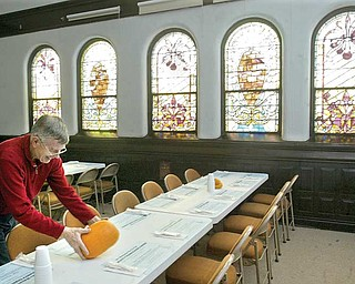 First Presbyterian Church employee Paul Rankin helps set tables for the the church's 30th annual community Thanksgiving dinner. He was preparing the tables Wednesday.