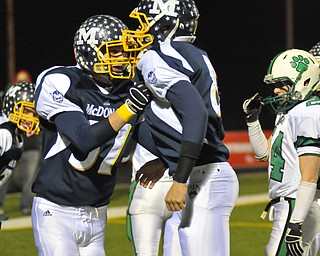 McDonals' Nick Chrsmark, left and QB Matthias Tayala celebrat their 1st quarter TD agains t Mogadore during their Div VI playoff game at Twinsburg on Friday night. Photo/Mark Stahl