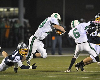 McDonald's Mike Helco make the open field tackle on Mogadore's Jake McAvinew during their Div VI playoff game at Twinsburg on Friday night. Photo/Mark Stahl