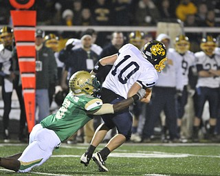 Ursuline's Keil'n Thurston takes down Kirtland QB Ryan Loncar during the 1st half of their game in Auora on Saturday night. Photo/Mark Stahl
