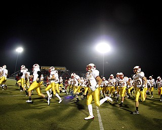 NOVEMBER 20 - RAVENNA-OHIO:  The Cardinal Mooney Cardinals run onto the field befor the start of play against the Akron Buchtel Griffs at Ravenna High School on November 20, 2010.  (photo by:  Justin K. Aller)