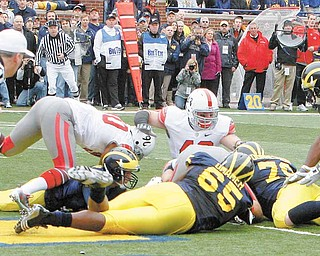 Ohio State recovers a fumble by Michigan quarterback Tate Forcier in the end zone for a touchdown during the first quarter of an NCAA football game in Ann Arbor, Mich., Saturday, Nov. 21, 2009.