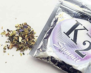 "This Feb. 15, 2010, file photo shows a package of K2 , a concoction of dried herbs sprayed with chemicals. Authorities in 13 states thought they were acting to curb a public health threat when they outlawed a form of synthetic marijuana known as K2: a concoction of dried herbs sprayed with chemicals. But even before the laws took effect, many stores that did a brisk business in fake pot had gotten around the laws by making slight changes to K2's chemical formula, creating knockoffs with names such as ""K3,"" ""Heaven Scent"" and ""Syn."""