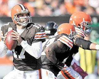 This Oct. 10, 2010, file photo shows Cleveland Browns quarterback Jake Delhomme (17) going back to pass against the Atlanta Falcons during an NFL football game in Cleveland.  With Colt McCoy out with a high left ankle sprain, Delhomme, who has been inactive for eight games because of a similar injury, will start Sunday against his former team, the Carolina Panthers.