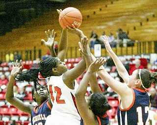 Brandi Brown shoots over a host of Bucknel defenders.