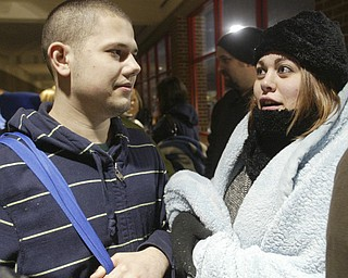 William D. Lewis|The Vindicator Sergio Matos of Youngstown and Stephanie Furman of Poland qued up outside the Boardman Target store at 4am Friday to get Black Friday bargins.