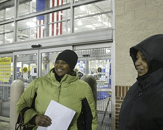 William D. Lewis|The Vindicator A large crowd qued up outside the Boardman Best Buy at 5am Friday to get Black Friday bargins. Nicole Nixon, left, and Marcee Richardson of New Castle of Youngstown were first in the line.