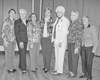 Lining up to accept the responsibility of various posts as they were installed as officers of the Garden Forum of the Greater Youngstown area for 2011-2012 are, from left, Irene John, Patricia Feindt, Lee Meadows, JoAnn Vlacancich, Charlene Flesch, Kay Zimmerman and Mary Schall.
