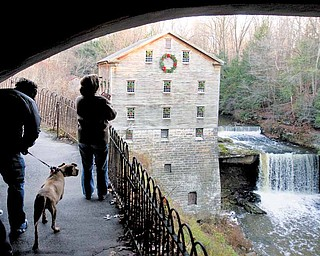 Lanterman's Mill was all decked out for Olde Fashioned Christmas at the Mill this weekend. A couple enjoyed the view of the historic mill in Mill Creek Park Sunday.