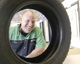 Tom Schadl, manager of Flynn's Tire & Auto Servicein Youngstown, is pushing the snow tires this year for winter driving.