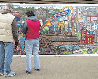 People who attended Mill Creek Park's Olde Fashioned Christmas at the Mill were treated to a 24-feet-long traveling mural by Bob Barko Jr. It depicts the history of Youngstown from 1796 to 2007.