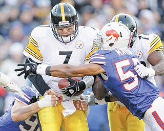 Pittsburgh Steelers' Ben Roethlisberger (7) is pressured by Buffalo Bills' Aaron Maybin (58) and Chris Kelsay (90) during the second half of an NFL football game in Orchard Park, N.Y., Sunday, Nov. 28, 2010. The Steelers won 19-16 in overtime.