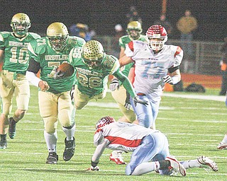 Ursuline's Akise Teague flies over Lima's Rufus Johnson for yards Saturday night in Ashland.