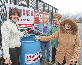 Autumn weather may call for sweaters and coats but plans for spring planting are on the minds Liberty in Bloom supporters. They promote recycling as a way to fund the planting project. From left are Liberty Township Trustee Jodi Stoyak, Carol Cupan, Janet Yaniglos and Bessie Anderson.