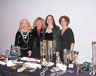 Angels for Animals, 4750 state Route 165, Canfield, will host its 7th annual Antiques and Holiday Decoration Show just in time for the holiday season. There will be a $5 admission charged for the preview from 6 to 9 p.m. Friday. From 10 a.m. to 3 p.m. Saturday and from noon to 4 p.m. Sunday there will be no charge. A large variety of collectibles, antiques and jewelry will be available, and all proceeds will benefit the animal shelter and its low-cost spay and neuter programs. Wearing and displaying some of the jewelry collected for the sale are, from left, Ruth Nabb; Chris Vogel; Diane Less, founder of Angels for Animals; and Susie Cope, chairwoman for the event. To donate items for the sale or for more information call 330-502-5352.
