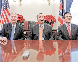 From left, Senate Republican Leader Mitch McConnell of Ky., House Speaker-designate John Boehner of Ohio, and House Majority Leader-elect Eric Cantor of Va., take part in a news conference, on Capitol Hill in Washington Tuesday, Nov. 30, 2010, following their meeting at the White House with President Obama.
