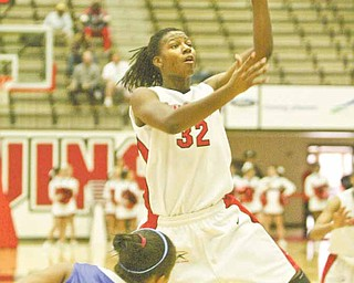 YSU's Tieara Jones shoots over IPFW's Kayla Drake during first half action Saturday at YSU.