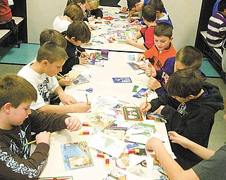 Fourth-grade students at Poland North Elementary worked with the Mahoning County Green Team to reuse holiday greeting cards as ornaments.