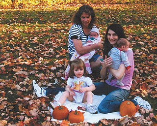 Linda Lamanna of Austintown enjoys a warm fall day with her daughter Jeannine Lindquist and grandchildren Kaylie Eva, center, and twins Jenna Marie and Nicholas James Lindquist. The Lindquist family lives in Minneapolis, Minn. Photo submitted by Linda Lamanna.