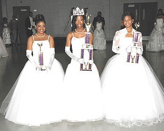 Holding the trophies they received as they were honored at the annual Junior Civic League's Cinderella Ball are, from left, Tiara Williams, second attendant; Asia Walker, Miss Cinderella; and Keisha Talley, first attendant.