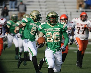 Ursuline's Akise Teague's first  of five touchdowns. The Ursuline Irish have achieved their primary season goal: to win the state title for a record third-straight time. The Fighting Irish had an impressive end to their season with a 51-21 victory over Coldwater in the Division V State Championship game at Canton's Fawcett Stadium Saturday, Dec. 4, 2010.