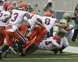 Sometimes it took a team to slow down Ursline's Akise Teague: Coldwater's  #54  Kyle Post, #8 Ross Wermert, #11 Trevor Koch,  #3 Aaron Rammel and #23  Jordan Chapin try to push Teague out of bounds after he gained a first down. The Ursuline Irish have achieved their primary season goal: to win the state title for a record third-straight time. The Fighting Irish had an impressive end to their season with a 51-21 victory over Coldwater in the Division V State Championship game at Canton's Fawcett Stadium Saturday, Dec. 4, 2010.