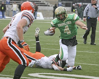Ursuline's #4 Paul Kemp makes the first down. Coldwater's #8 Ross Wermert watches as teammate #21 Reese Klenke trips him up. The Ursuline Irish achieved their primary season goal: to win the state title for a record third-straight time. The Fighting Irish had an impressive end to their season with a 51-21 victory over Coldwater in the Division V State Championship game at Canton's Fawcett Stadium Saturday, Dec. 4, 2010.